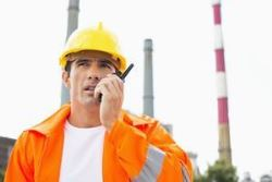 On-site Radio System, Wide Area Radio Network or Mobile Phone?