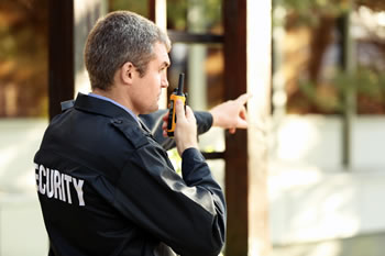 Security guard with two-way radio
