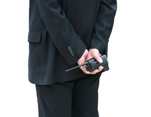 Security personnel with two way radio