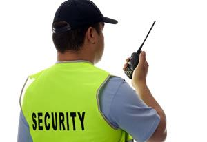 Security guard using two way radio
