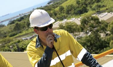 Construction worker with two way radio