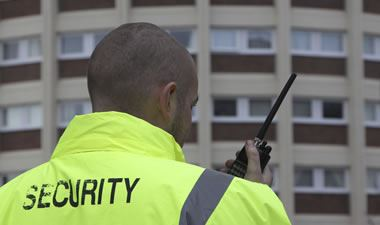 Security guard with two way radio